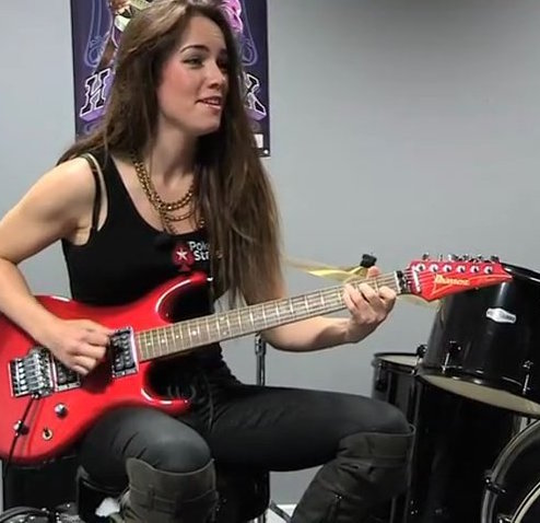 Liv Boeree playing the guitar